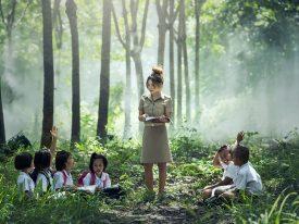 Teacher and enjoys the environment of outdoor class