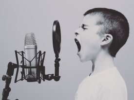 Kid practice on his song before the recording